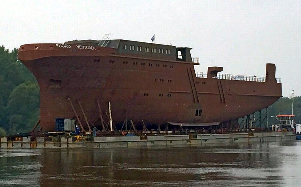 Fugro Venturer hull on a heavy-lift ponton-barge prior to launching. Photo: Hullkon