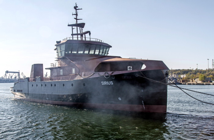 Hull of multi-function rescue and environment protection vessel Sirius under tow, departing the port of Gdynia. Photo: Piotr B. Stareńczak