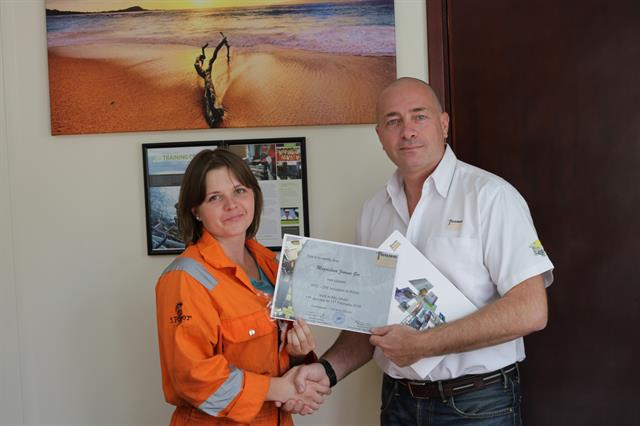 Magdalena Joanna Gos receiving training certificate from Massimo Brebbia of Fugro.