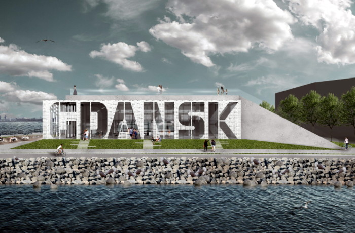 "A grass-covered mound at the entrance to the port with a ""Port Gdansk"" (Port of Gdansk) sign."