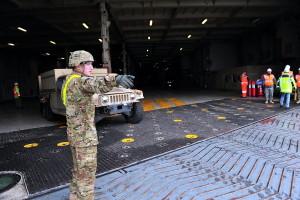 US Army military vehicles leaving the ship via a stern ramp. Photo: Sgt.1st Class Jacob McDonald