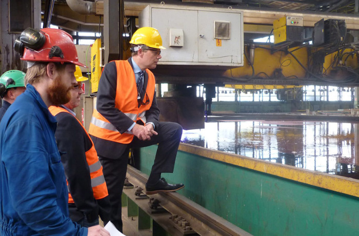Steel cutting marks the production start of a shipbuilding project, here closely watched by Ulstein Verft and Color Line representatives at Crist yard, Gdynia, Poland.