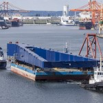 structures for Meyer Turku new Goliath gantry crane under tow, departing the port of Gdynia