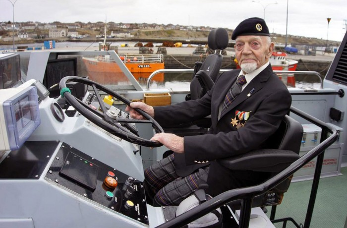 Trying out the helmsman's chair on board patrol boat HMS Example is former sailor Richard Polanski - one of the last men still alive to see Hitler's flagship Bismarck in its death throes.